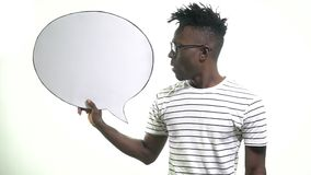 A black man in hipster glasses says in a dialog cloud. Black man explains and gestures in the cloud dialog stock video footage