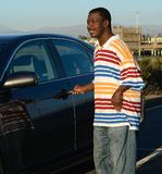 Black Man and his Car. On a sunny day Royalty Free Stock Photography