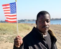 Black Man Holding The American Flag. On the beach Royalty Free Stock Photography