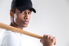 Black man holding bat Royalty Free Stock Photo