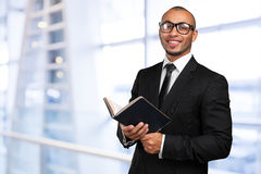Black man holding a book Royalty Free Stock Images