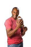 Black Man holding football Stock Image