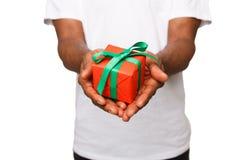 Black man holding gift box isolated on white background. Black man holding a gift box in hands isolated on white background. Present, holiday, congratulations Royalty Free Stock Photo