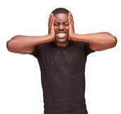 Black man holding his head in pain and depression royalty free stock image