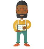 Black Man holding a screen tablet Royalty Free Stock Images
