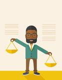 Black man holding a weighing scale Royalty Free Stock Image