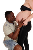 Black man kissing baby belly. Royalty Free Stock Photography