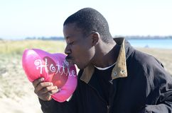 Black Man kissing his valentine Royalty Free Stock Image