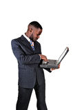 Black man with laptop. stock images