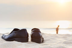 Black man leather shoe on the beach. Close up black man leather shoe on the beach Royalty Free Stock Images