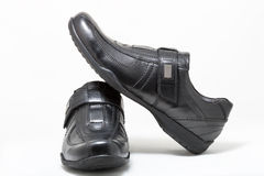 Black man leather shoes with velcro on white Royalty Free Stock Image