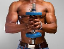 Black man lifting gym weight Stock Photo