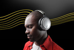 Black man listening music Stock Photography