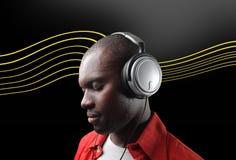 Black man listening music Stock Photography