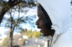 Black Man listening to Music. In the park Stock Photo