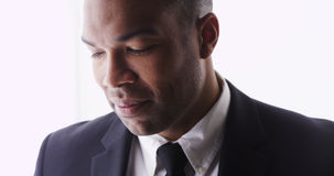 Black man looking at camera wearing suit Stock Photos