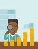 Black man looking at his growing business using. A black man looking his growing business in financial crisis concept. Economy and money, coin and success. A Royalty Free Stock Photo