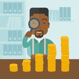 Black man looking at his growing business using. A black man looking his growing business in financial crisis concept. Economy and money, coin and success. A Stock Images