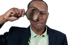 Black Man Looking through a magnifying glass Royalty Free Stock Photo