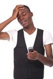 Black man looking at the phone Stock Image