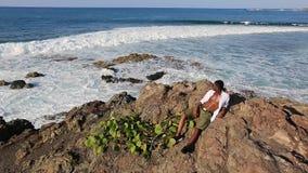 Black man looks at the ocean stock video