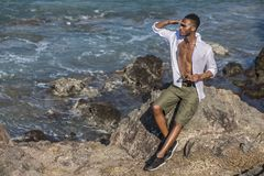 Black man looks at the ocean Royalty Free Stock Photo