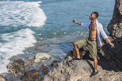 Black man looks at the ocean Stock Images