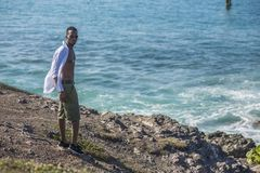 Black man looks at the ocean Stock Photo