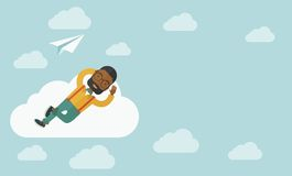 Black man lying on a cloud with paper plane Stock Photo