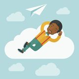 Black man lying on a cloud with paper plane Stock Images