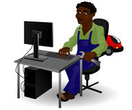 Mechanic sitting at the computer Royalty Free Stock Image