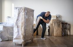 Black man moving furniture to new house Royalty Free Stock Images