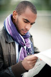 Black man with newspaper Royalty Free Stock Photography