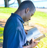Black Man In The Park. Looking Royalty Free Stock Photography