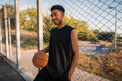 Black man playing basketball, street ball, man playing, sport competitions, afro, outdoor portrait Royalty Free Stock Photography