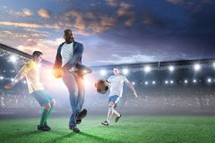 Black man plays his best soccer match. Mixed media stock photo