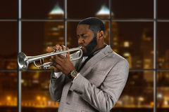Black man plays the trumpet. Stock Image