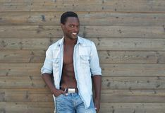 Black man posing outdoors with open shirt Royalty Free Stock Images