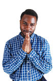 Black man praying. Royalty Free Stock Photography