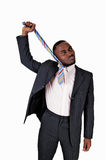 Black man pulling his tie. Stock Images