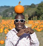 Black Man at Pumpkin Patch Royalty Free Stock Photos