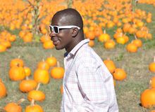 Black Man at Pumpkin Patch Royalty Free Stock Images