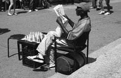 Black man reading the Newspaper. In Union square, New York stock photo