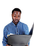 Black man reading paper. Royalty Free Stock Photography