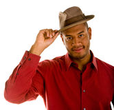 Black Man in Red Shirt Tipping Brown Hat Royalty Free Stock Photography