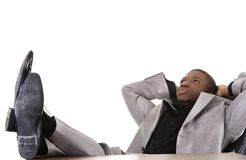 Black man relaxing in the office Stock Image