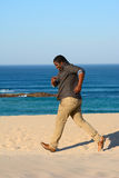 Black man jogging on beach Royalty Free Stock Image