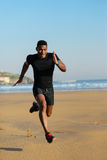 Black man running and sprinting at the beach Royalty Free Stock Image