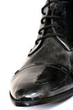 Black man's boot Stock Images
