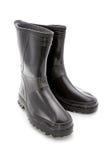 Black man's rubber boots Stock Photos